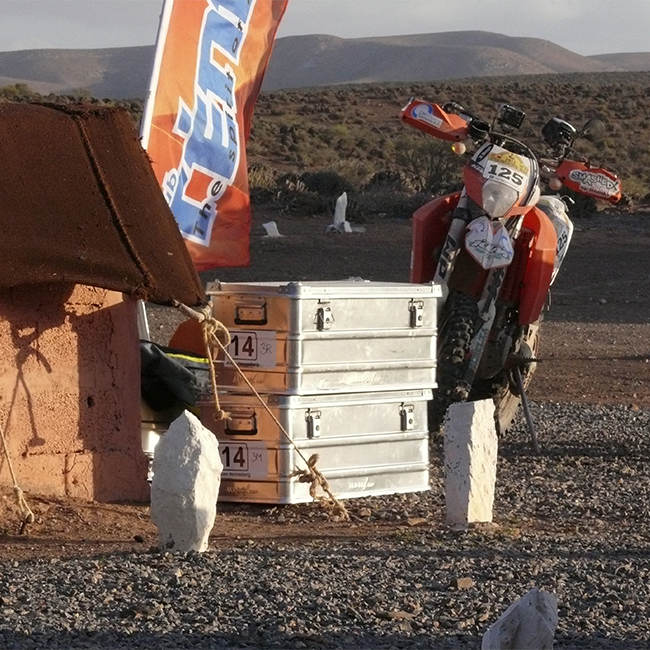 Alubox.com A081 Expedition to Sahara rally, a bike and a stack of boxes